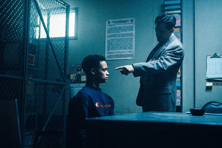 A detective points at a kid he's interrogating in a still image from When They See Us.