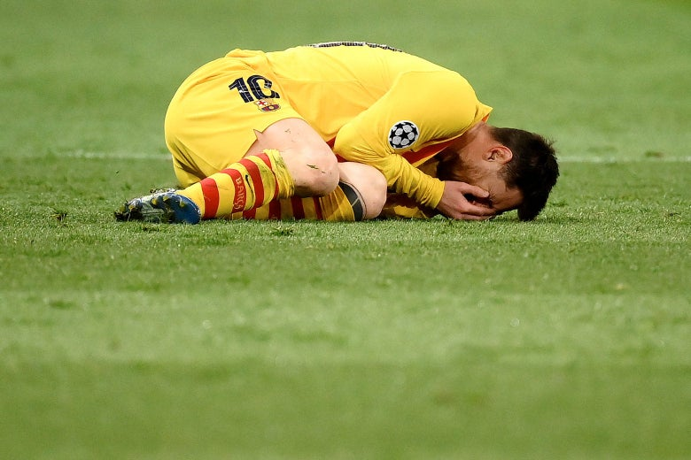 Messi curled up on the pitch with his face in his hands crying