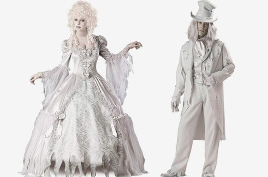 Couple dressed as ghostly figures.