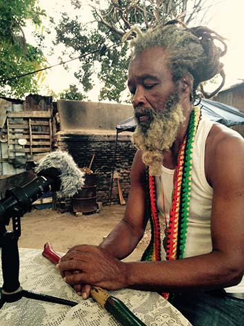 Ras Ayatollah speaks with the writer in the yard at Ibo Spice in