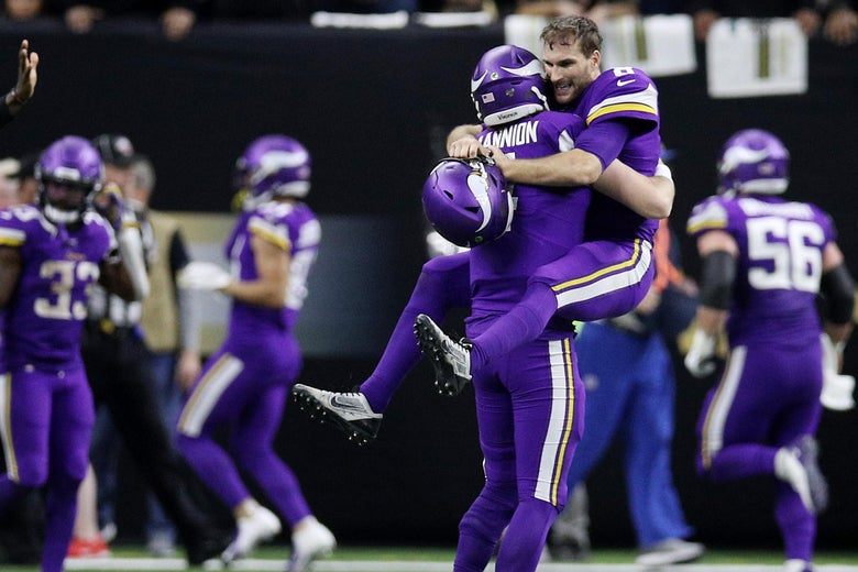 Kirk Cousins of the Minnesota Vikings celebrates with teammates.