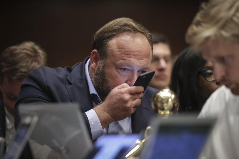 Alex Jones of InfoWars speaks into his phone during a Senate Intelligence Committee hearing concerning foreign influence operations' use of social media platforms, on Capitol Hill, September 5, 2018 in Washington, D.C.