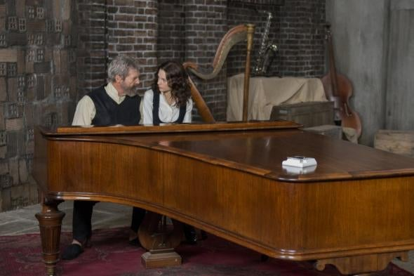 Jeff Bridges and Taylor Swift sit at a piano in a still from the movie.