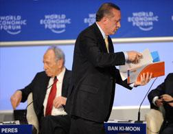 Turkish Prime Minister Recep Tayyip Erdogan leaves a debate. Click image to expand.