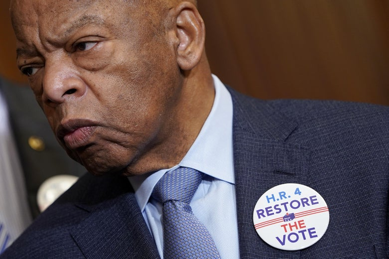 Rep. John Lewis listens as speaker of the House Nancy Pelosi (who is just outside of the photo) speaks about the Voting Rights Enhancement Act on Capitol Hill on February 26, 2019 in Washington, DC.