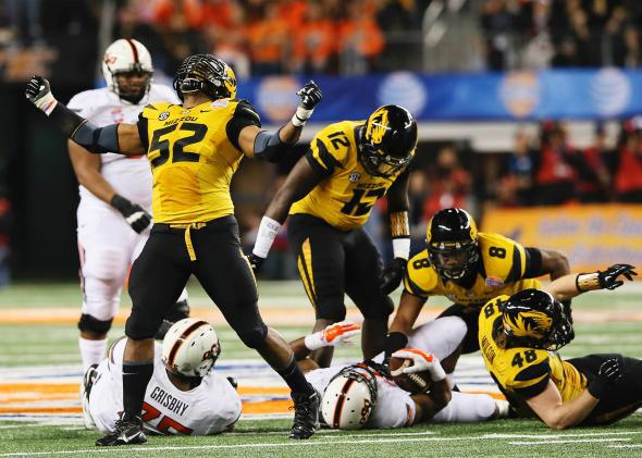 The Missouri Tigers' Michael Sam, No. 52, reacts after a play against the Oklahoma State Cowboys in the 2014 Cotton Bowl.