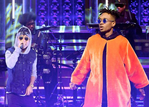 THE TONIGHT SHOW STARRING JIMMY FALLON -- Episode 0174 -- Pictured: (l-r) Swae Lee and Slim Jimmy of musical guest Rae Sremmurd perform with The Roots on December 2, 2014