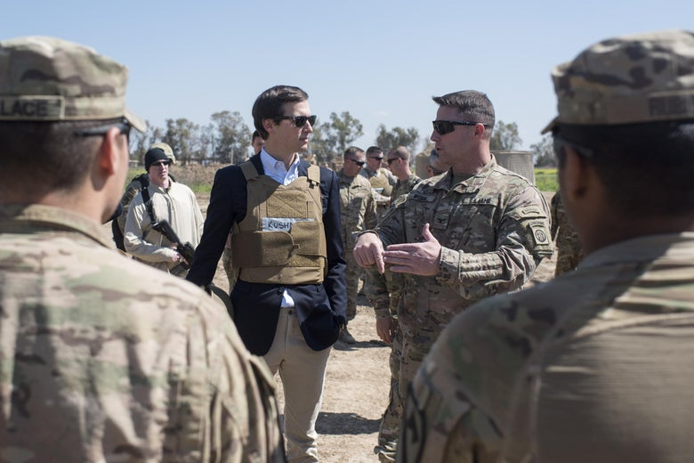 Jared Kushner meets with American troops in Iraq wearing a sport coat, sunglasses, and a flak jacket.