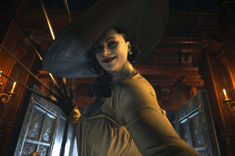 A woman with a big white hat, black hair, red lips, and pale white skin bares her claws as she eyes and smiles at the camera.