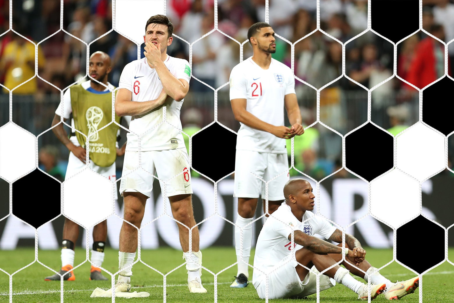 Ashley Young and Harry Maguire of England show their dejection.