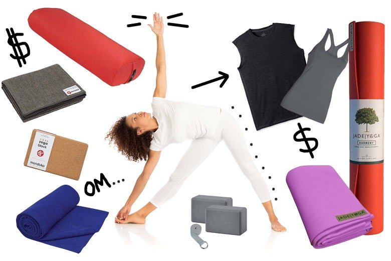 A woman in a yoga pose, surrounded by the necessary materials.