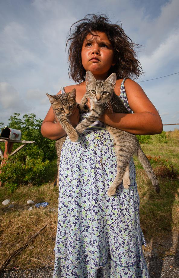 Member of the Biloxi-Chimacha-Choctaw tribe on Isle de Jean Charles with kittens.