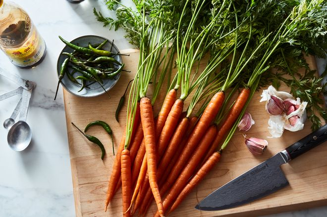 Carrots on a cutting board.