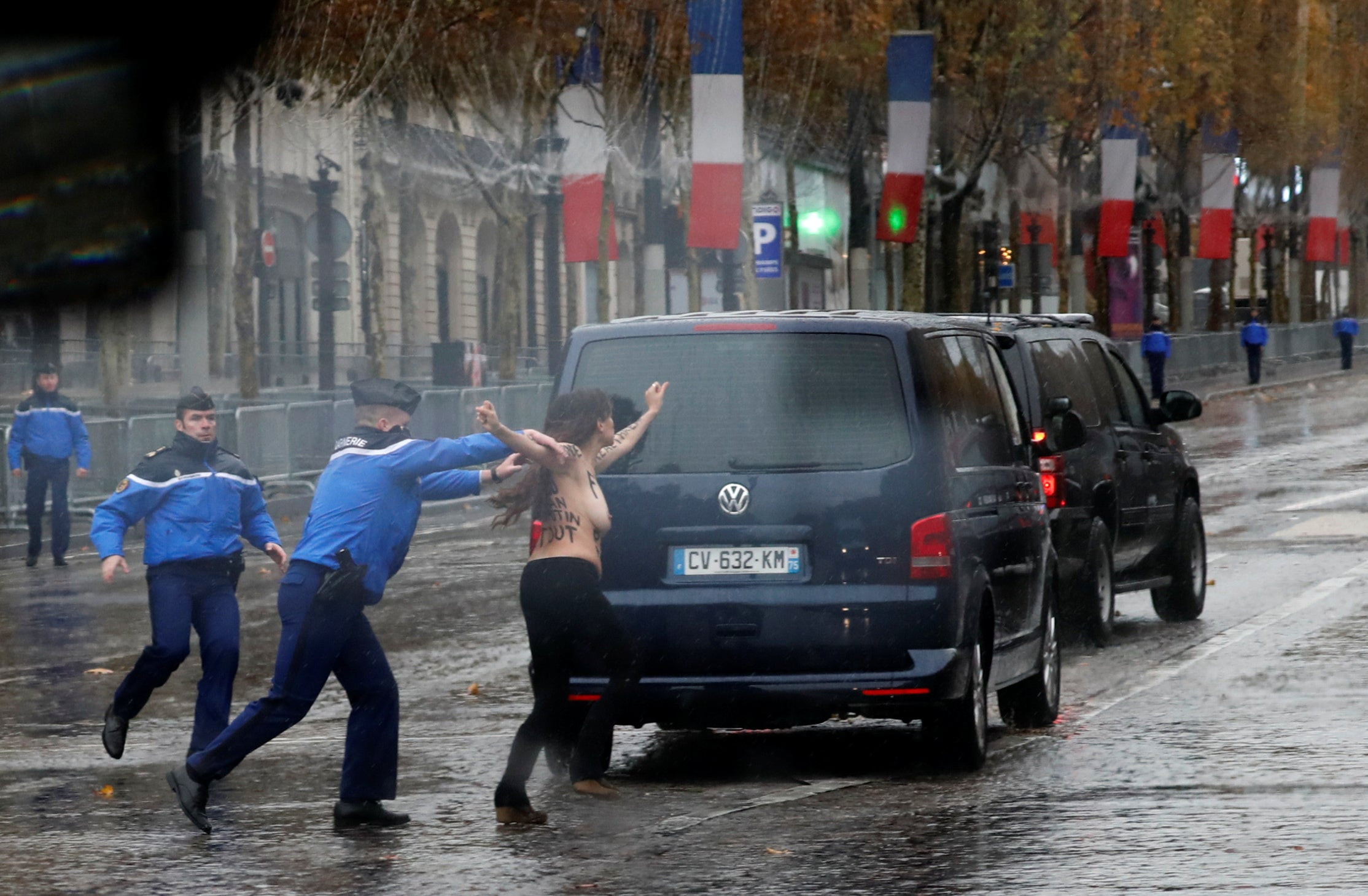 A protester tries to jump into the motorcade of President Donald Trump on his way to the commemoration ceremony for Armistice Day in Paris, France on November 11, 2018.