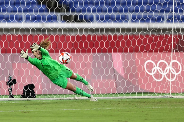Naeher dives and saves the ball in the net