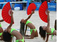 Cheerleaders perform during the women's and men's Beach Vollyball. (THOMAS COEX/AFP/Getty Images)