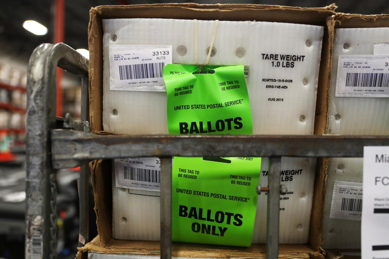 Boxes of ballots stacked on a cart before delivery