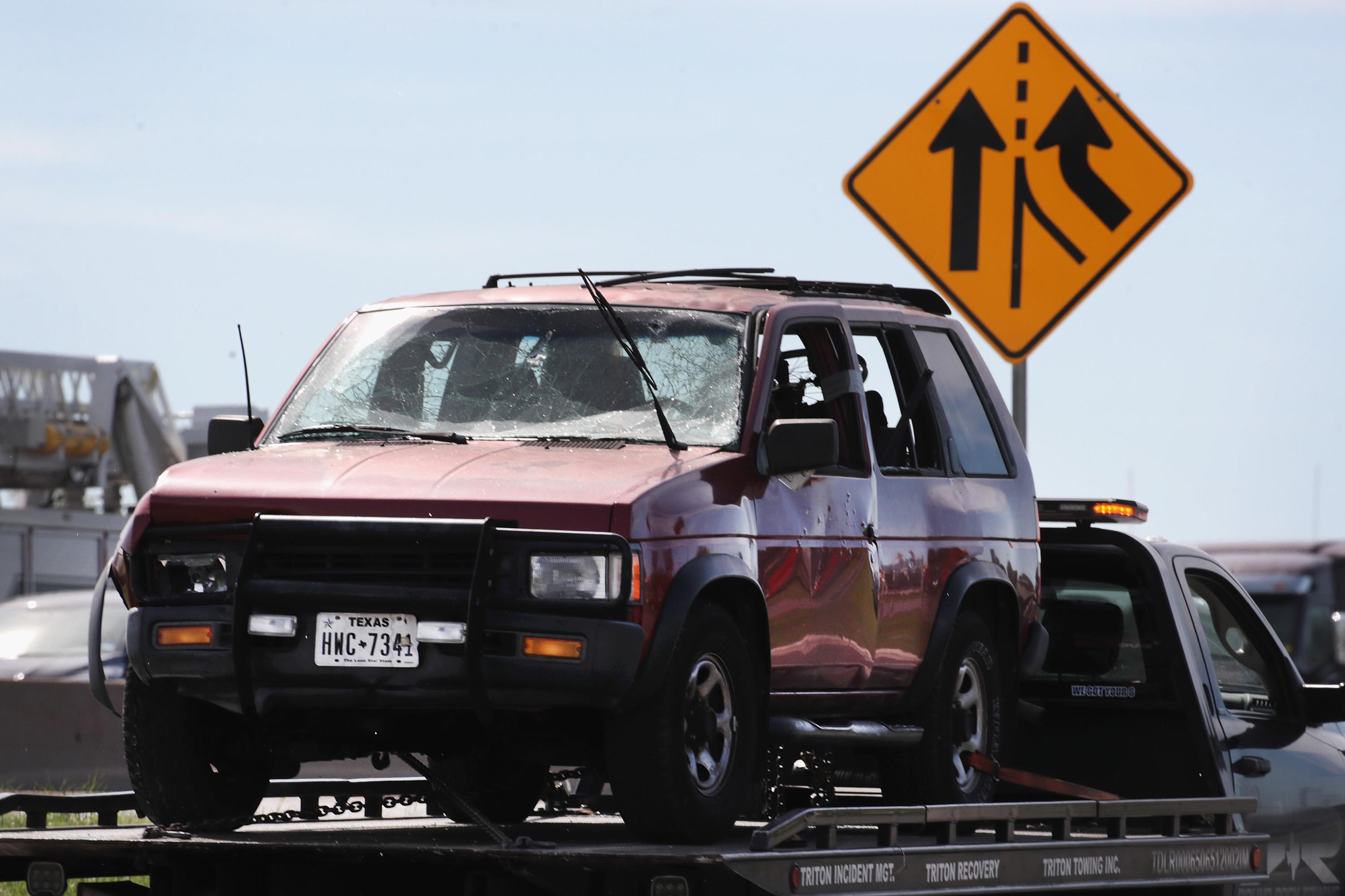 The vehicle that the Austin package bomber, Mark Anthony Conditt, was driving when he blew himself up is towed from the crime scene along Interstate 35 in suburban Austin on March 21, 2018 in Round Rock, Texas.