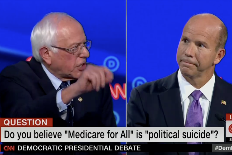 "In this screengrab from CNN, Bernie Sanders and Tom Delaney argue. The banner reads: ""Do you believe 'Medicare for All' is 'political suicide' ?"""
