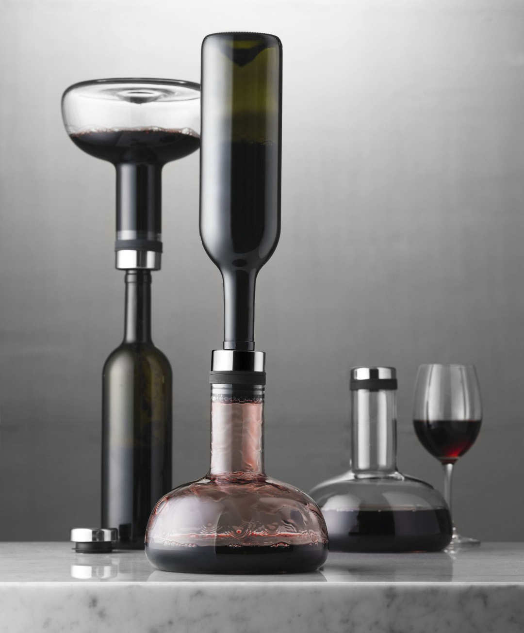 One bottle being aerated right-side up, and one bottle being aerated upside-down.