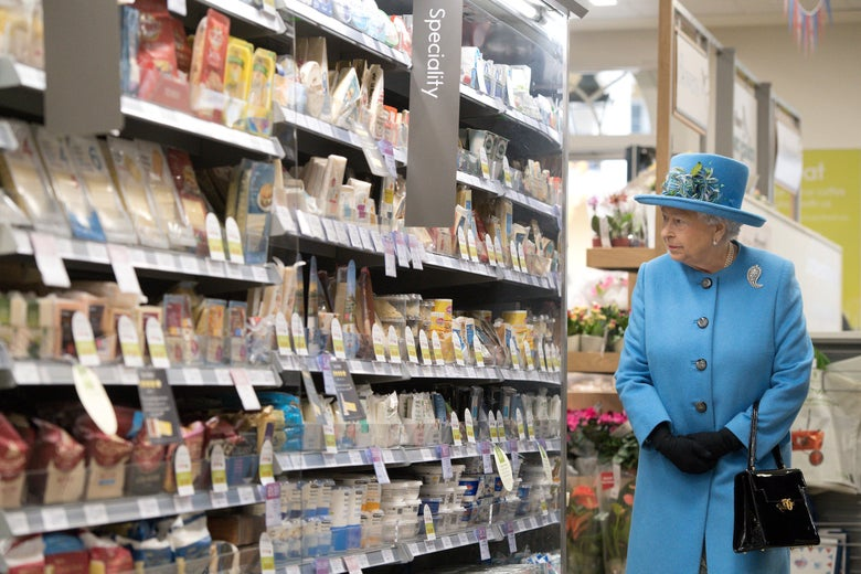 Queen Elizabeth II looks at products on the shelves at a Waitrose supermarket during a visit to the town of Poundbury on October 27, 2016 in Poundbury, Dorset.
