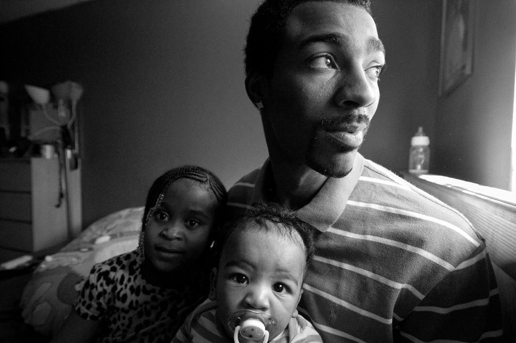 Bronx, New York, 2011. Guy Miller gets ready for an afternoon nap with daughter Nijeyah and son Guy Jr.