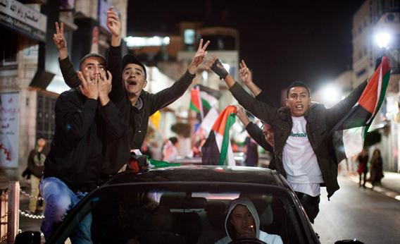 Palestinians in Ramallah, the West Bank celebrate the UN General Assembly's decision.