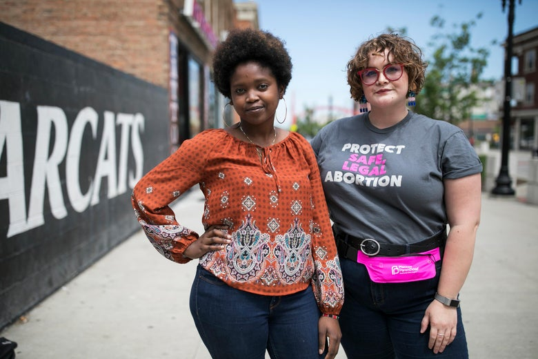 Elizabeth Thuranira and Caroline Lembright pose for a portrait in Cincinnati on May 11.