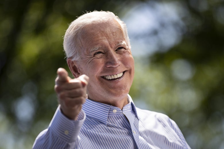 Joe Biden points toward the camera.