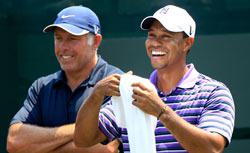 Tiger Woods (R) laughs as he talks with caddie Steve Williams (L) during a practice round prior to the start of THE PLAYERS Championship. Click image to expand.