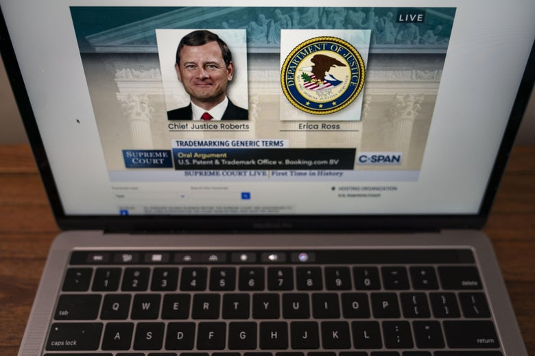 MacBook open to the Supreme Court livestream with John Roberts' photo on the screen as he speaks