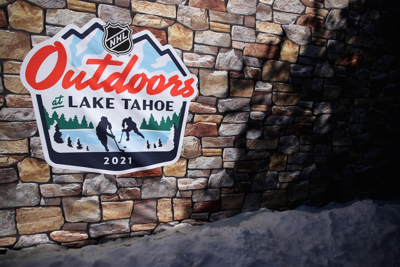 """An """"NHL Outdoors at Lake Tahoe"""" sign is seen on an exterior wall."""