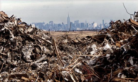 The Empire State Building and the Manhattan skyline are framed by some of the hundreds of thousands of tons of debris from the attacks on the World Trade Center that are piled at the Fresh Kills landfill on the Staten Island section of New York City, January 14, 2002.