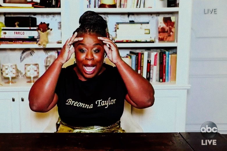 Uzo Aduba in front of a bookcase.