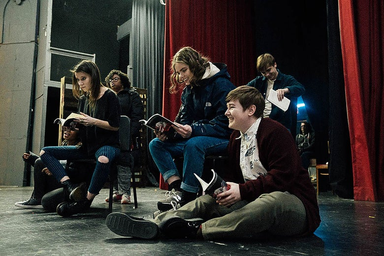 Characters in Rise sit onstage.