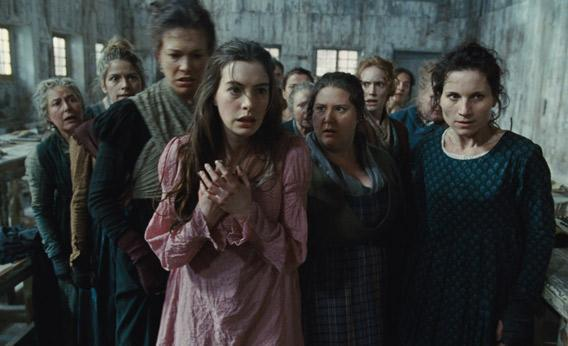 """Fantine (ANNE HATHAWAY) is thrown out of the factory in """"Les Misérables""""."""
