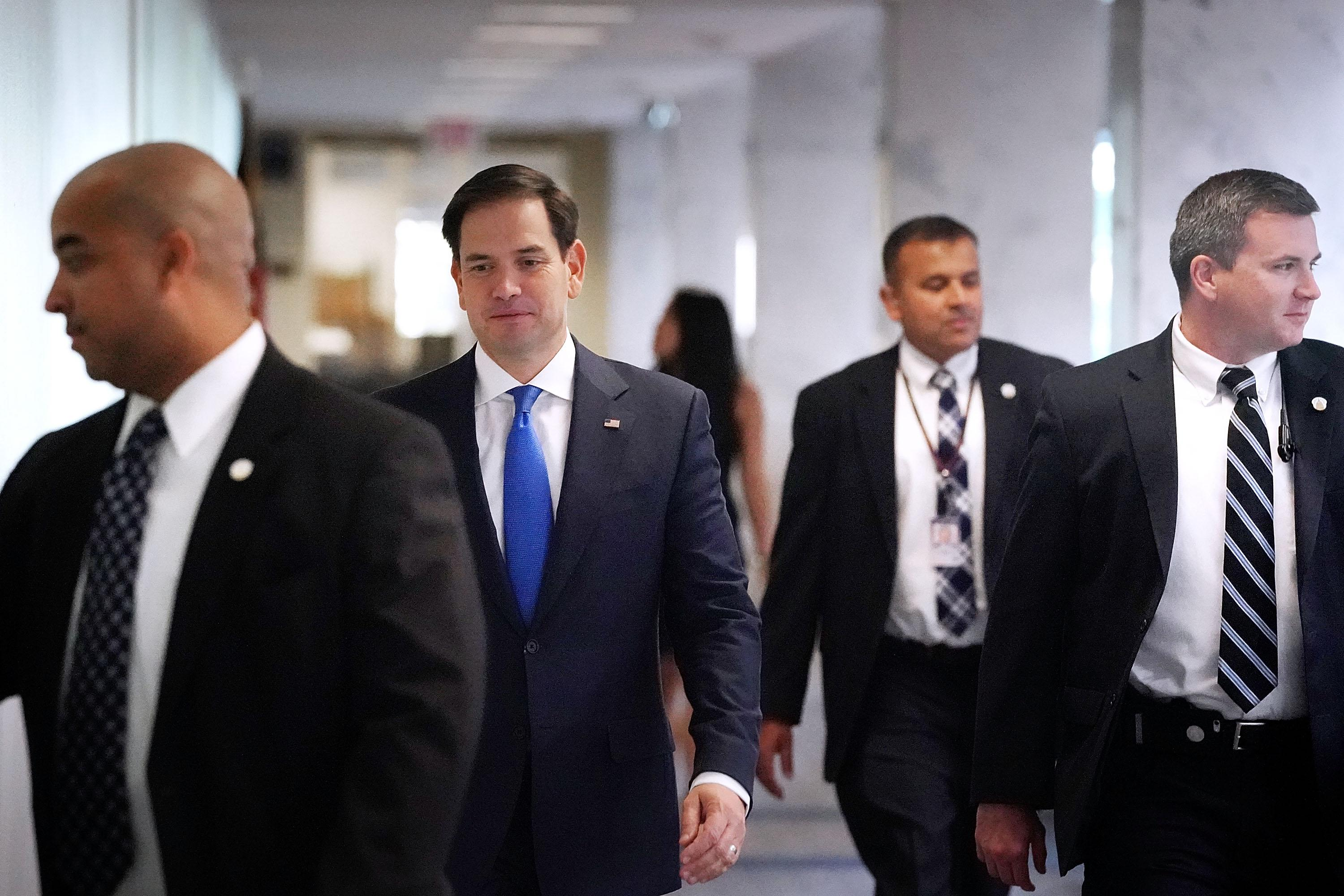 WASHINGTON, DC - OCTOBER 26:  Senate Intelligence Committee member Sen. Marco Rubio (R-FL) (2nd L) is flanked by plain-clothed U.S. Capitol Police as he arrives for a classified hearing at the Hart Senate Office Building on Capitol Hill October 26, 2017 in Washington, DC. The committee advanced legislation that would reauthorize Section 702 of the FISA Amendments Act, which enables the government to collect foreign intelligence on U.S. soil.  (Photo by Chip Somodevilla/Getty Images)