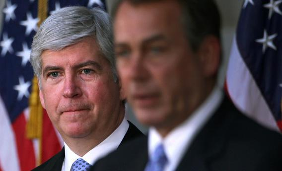 Governor Rick Snyder of Michigan listens to Rep. John Boehner during a dedication ceremony.