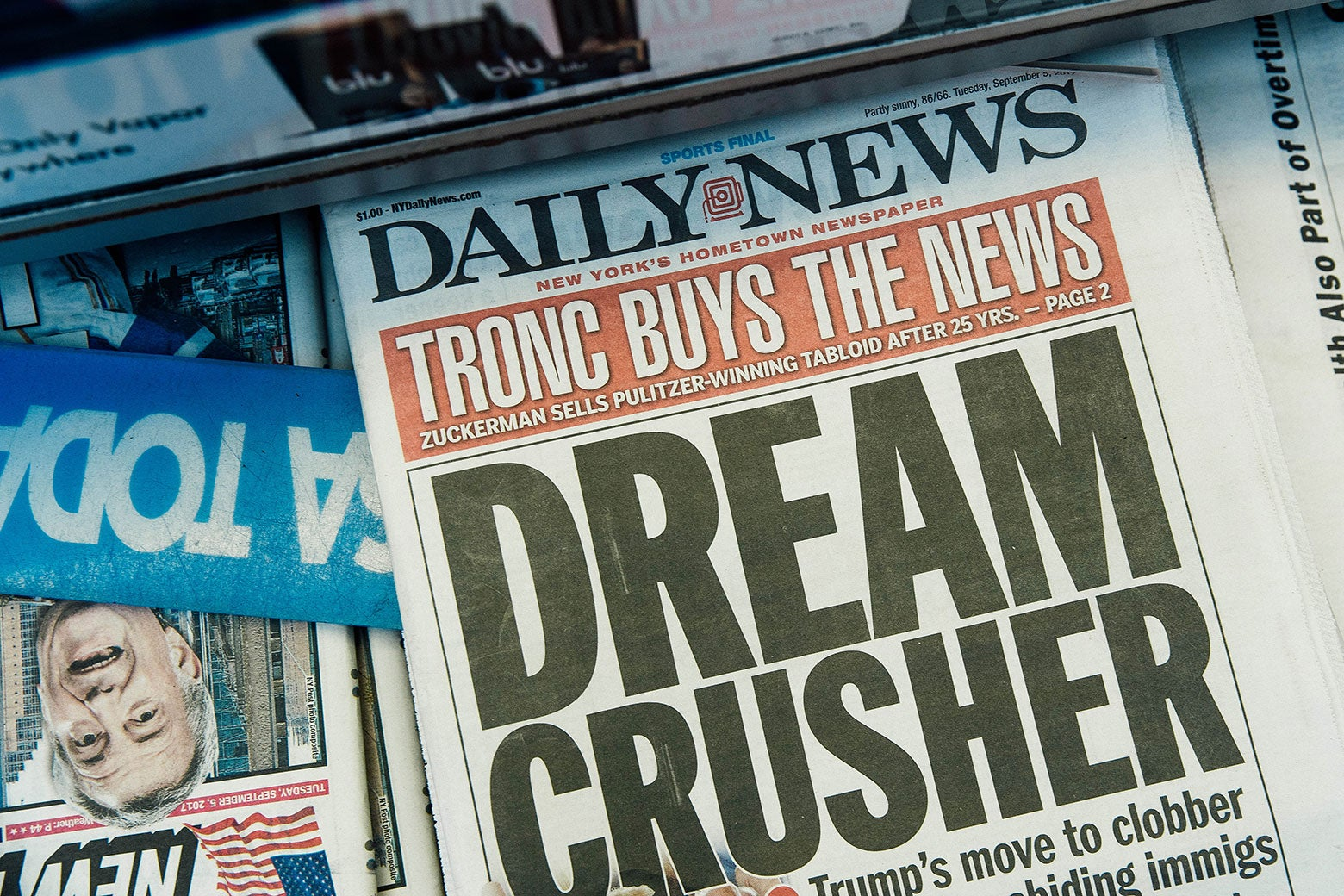"A newsstand copy of the New York Daily News announces the paper's sale to Tronc: ""TRONC BUYS THE NEWS."""
