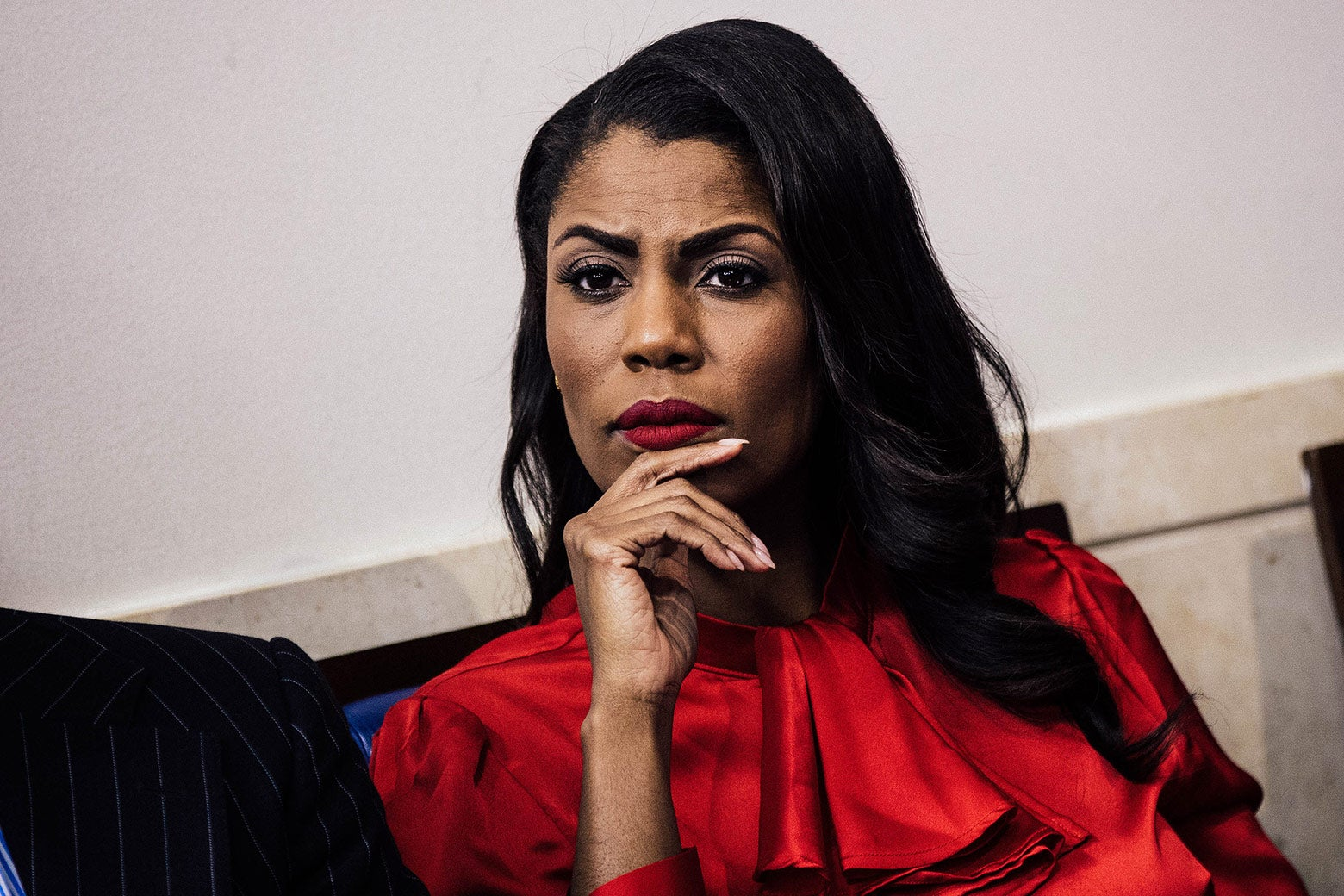 Omarosa Manigault listens during the daily press briefing at the White House on Oct. 27.