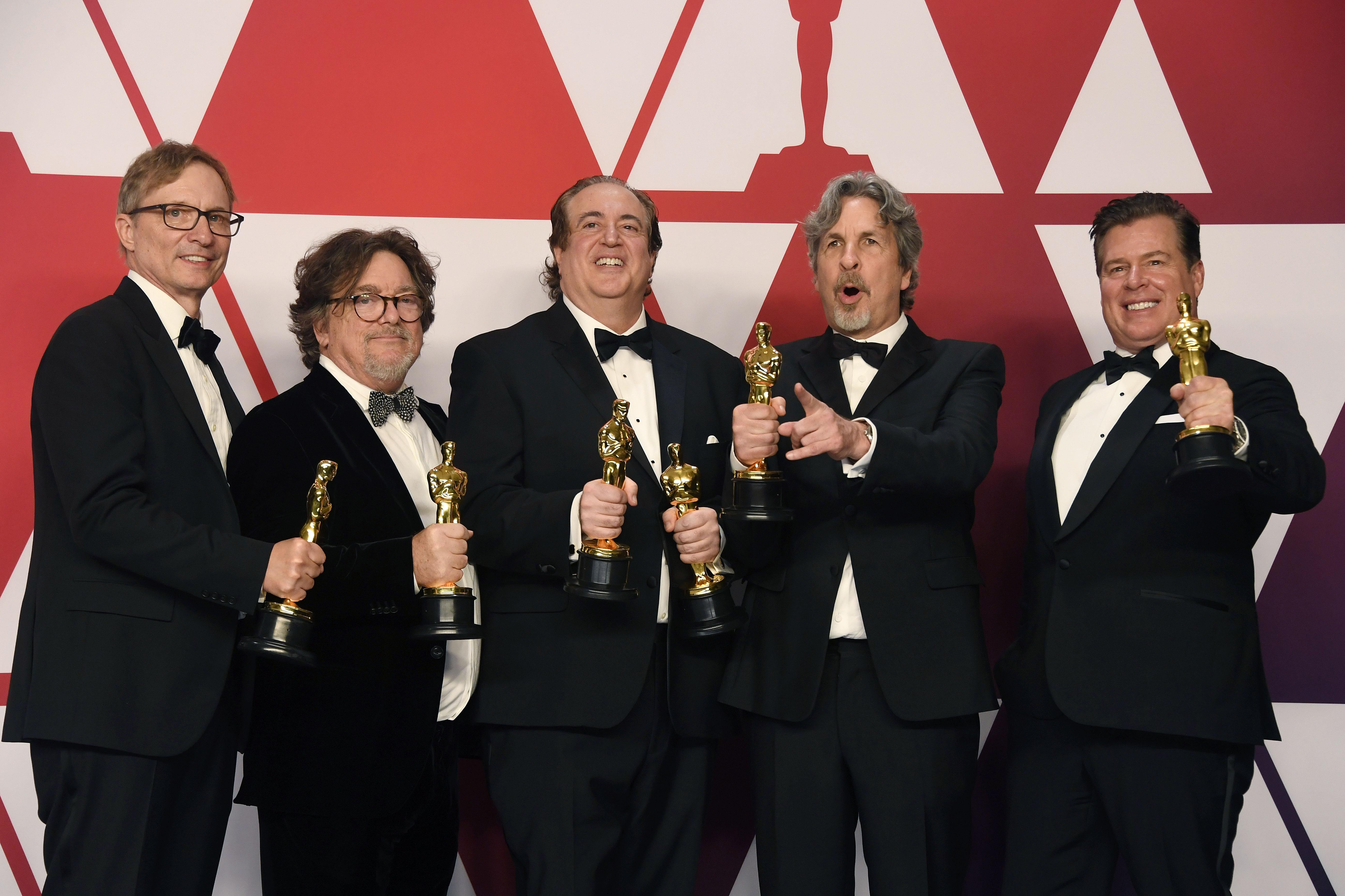 Peter Farrelly, holding out his little golden man, and all the other Best Picture winners for Green Book.