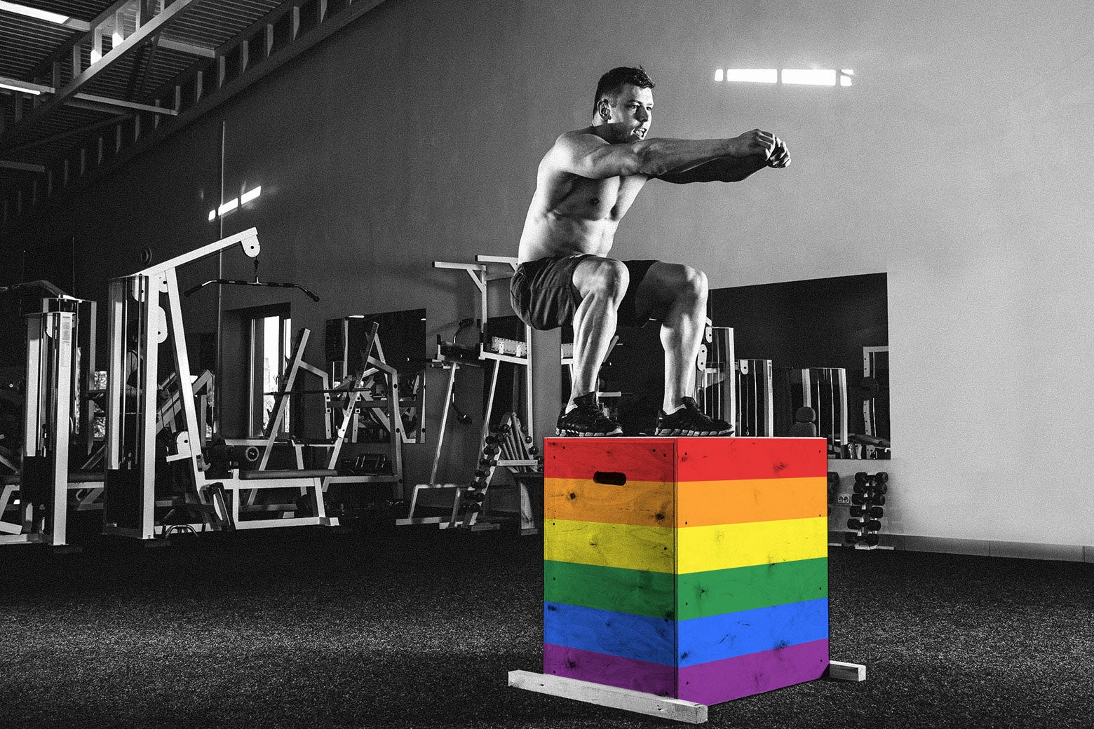 Photo illustration: A man does a box jump at the gym. The boxes have been edited to reflect a rainbow flag.