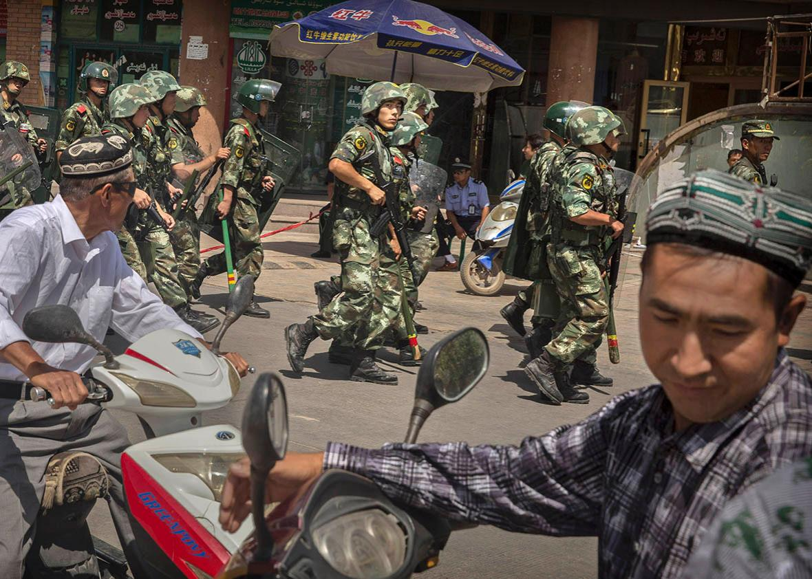 Chinese soldiers march past near the Id Kah Mosque, China's larg