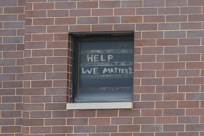 "The words ""help we matter 2"" are seen written in a window at the Cook County Department of Corrections."