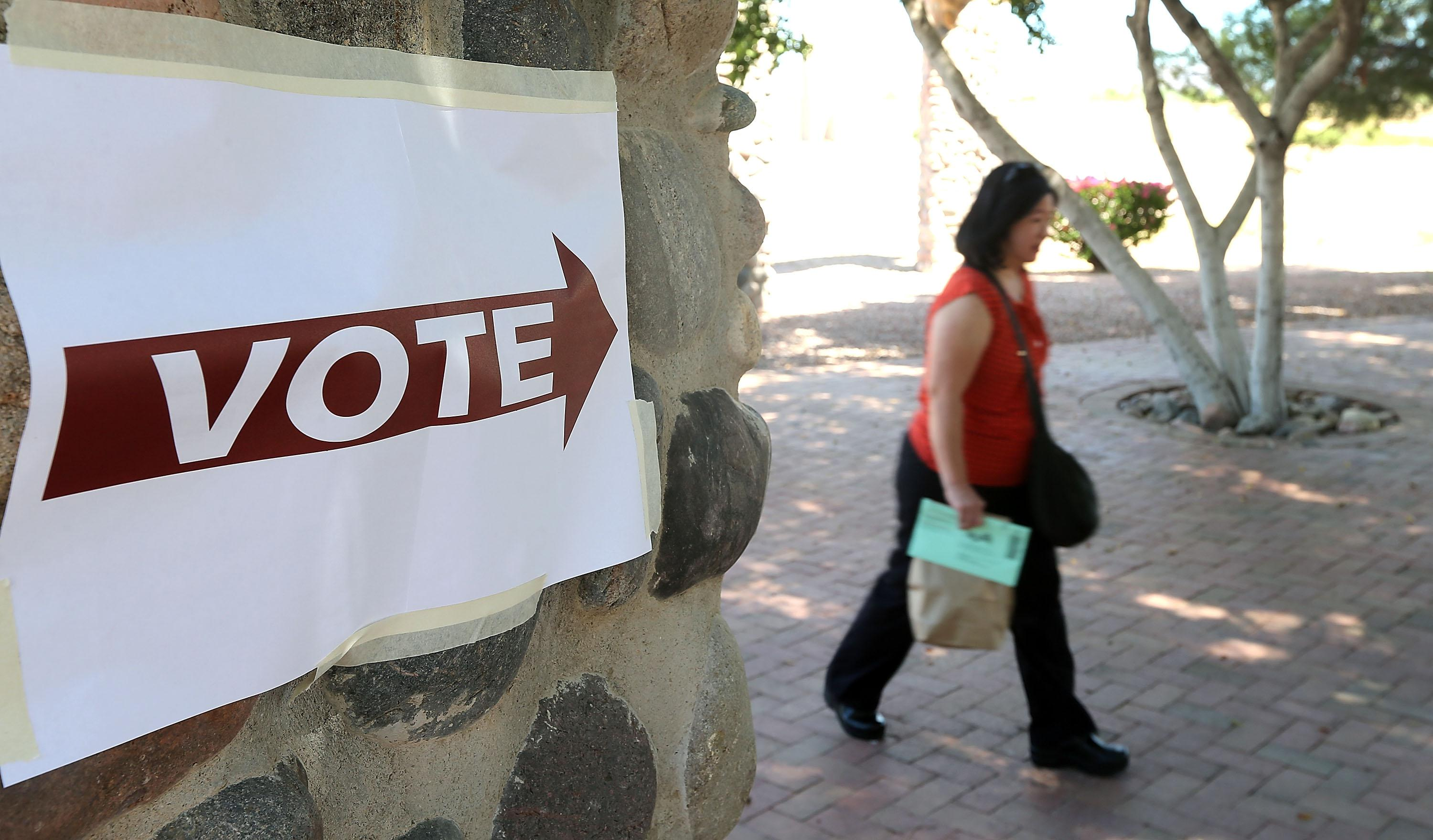 Arizona voters make their way to a polling place.