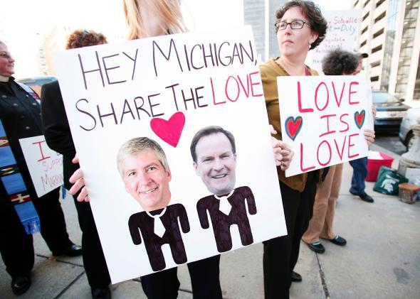 People in favor of same-sex marriage rally before an October 2013 hearing on Michigan's ban on same-sex marriage.