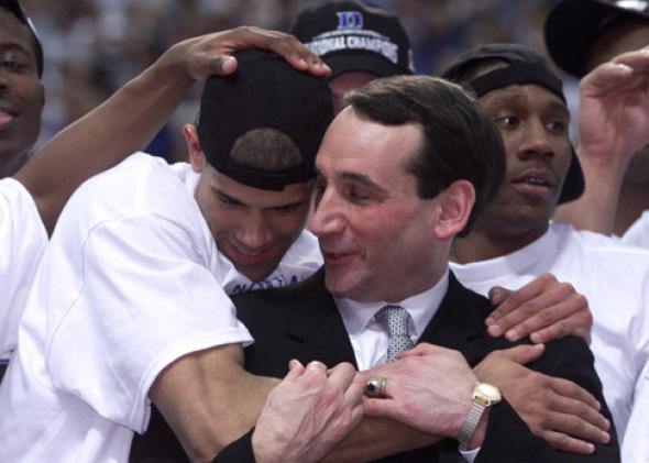 Head coach Mike Krzyzewski hugs his player Shane Battier #31 after defeating Arizona 82-72.