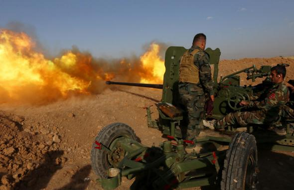 Iraqi Kurdish Peshmerga fighters fire an anti-tank cannon on the front line near Hasan Sham village, some 45 kilometres east of the city of Mosul, during an operation aimed at retaking areas from the Islamic State group on May 29, 2016. The 'peshmerga-led ground offensive, backed by international coalition warplanes' started before dawn, the Kurdistan Region Security Council (KRSC) said. The fresh push against the jihadist organisation comes a week after Iraqi forces launched an operation against Fallujah, IS's only other major urban hub in Iraq.\