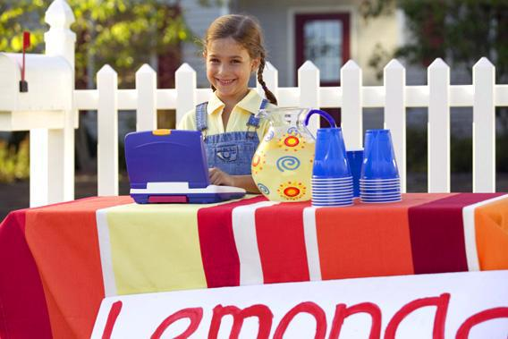 Girl at lemonade stand.