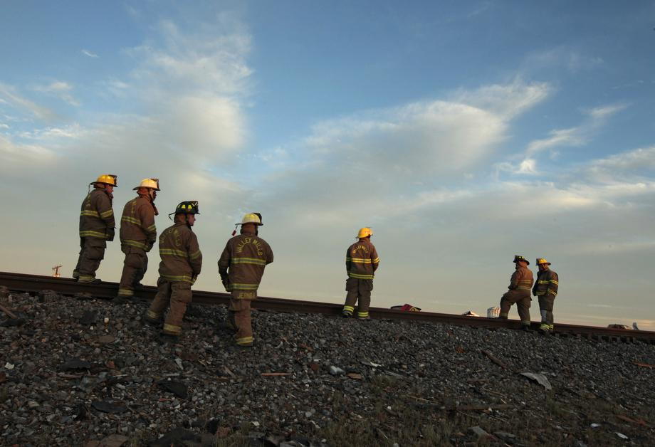 Valley Mills Fire Department personnel view the railroad tracks near to the fertilizer plant that exploded yesterday afternoon on April 18, 2013 in West, Texas.